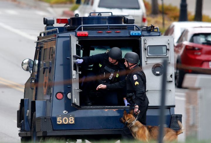 Law enforcement officials are seen outside of a parking garage on the campus of Ohio State University as they respond to an a