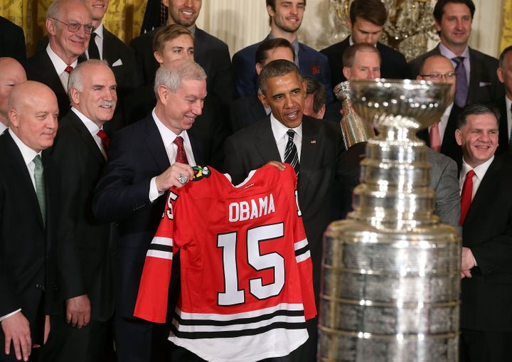 Obama with the team jersey he received as a gift from the Blackhawks.