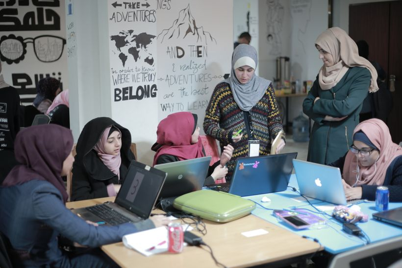 Ghadeer and other entrepreneurs at work at the Gaza Sky Geeks coworking space