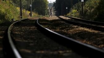 A man walks across tracks in an area where a Nazi train is believed to be, in Walbrzych, southwestern Poland August 30, 2015.     REUTERS/Kacper Pempel/File Photo