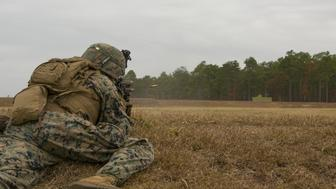 A Marine with the 1st Battalion 8th Marine Regiment engages a target during a fire and maneuver range at Camp Lejeune NC Nov 29 2016 Three women were scheduled to join the unit as the Marines first female infantrymen on Thursday