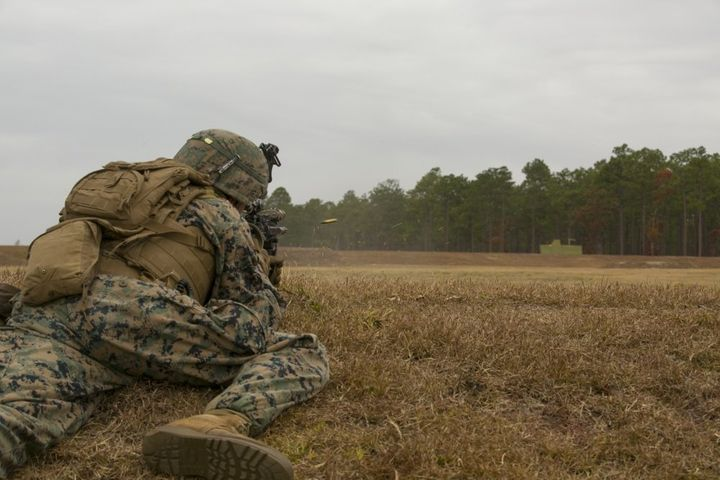 A Marine with the 1st Battalion, 8th Marine Regiment engages a target during a fire and maneuver range at Camp Lejeune, North