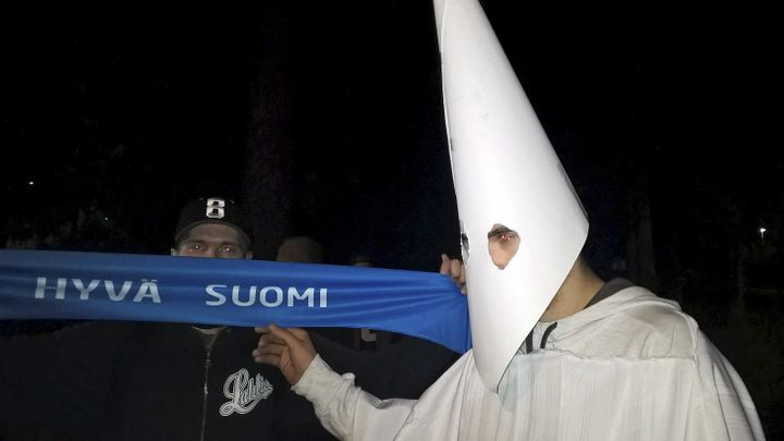 A demonstrator wearing a Ku Klux Klan outfit attends a protest against refugees in Lahti, Finland September 24, 2015.