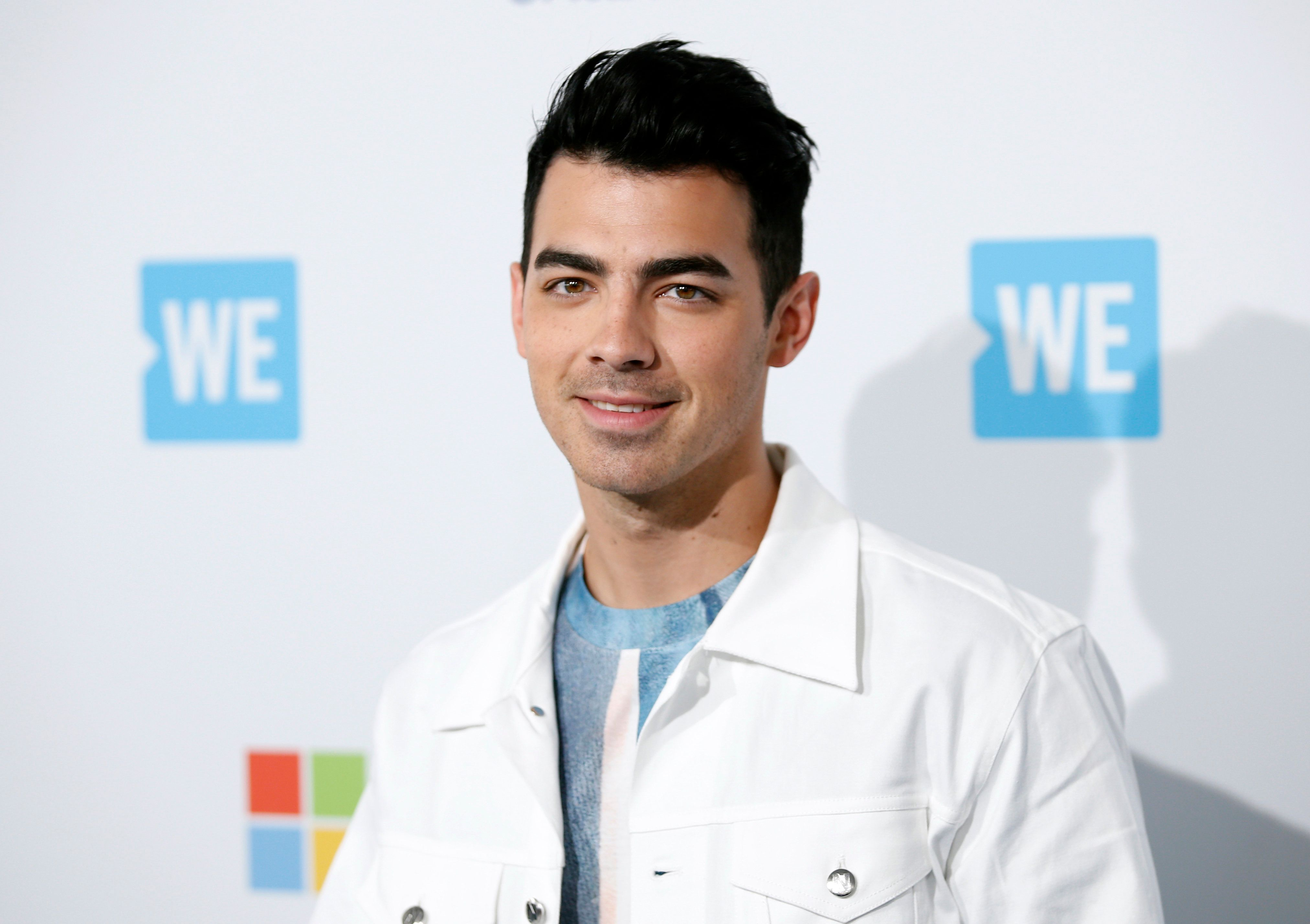 Singer Joe Jonas poses at We Day California in Inglewood, California, April 7, 2016. REUTERS/Danny Moloshok