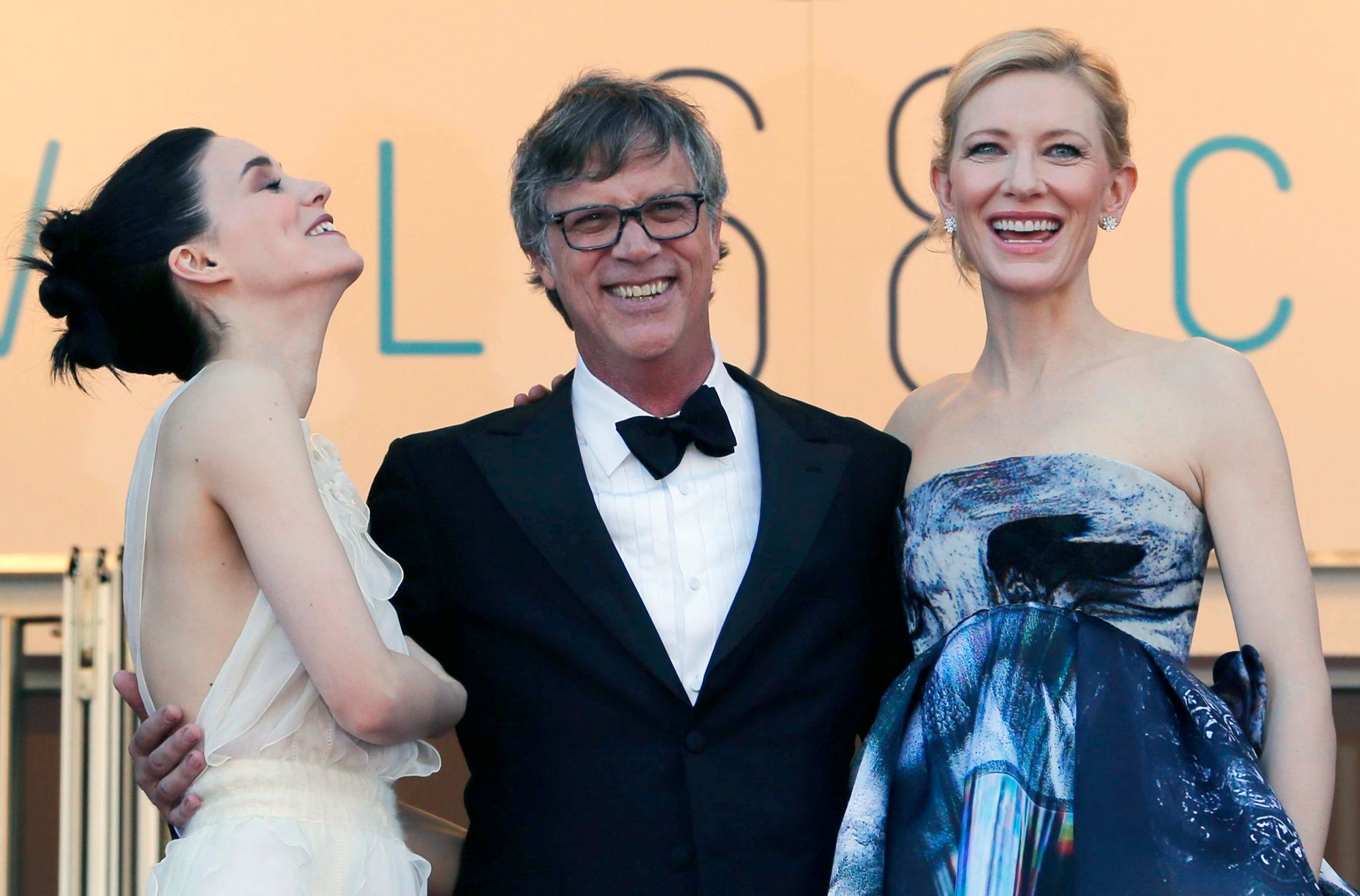 "Director Todd Haynes (C), cast members Rooney Mara (L) and Cate Blanchett pose on the red carpet as they arrive for the screening of the film ""Carol"" in competition at the 68th Cannes Film Festival in Cannes, southern France, May 17, 2015.            REUTERS/Regis Duvignau"