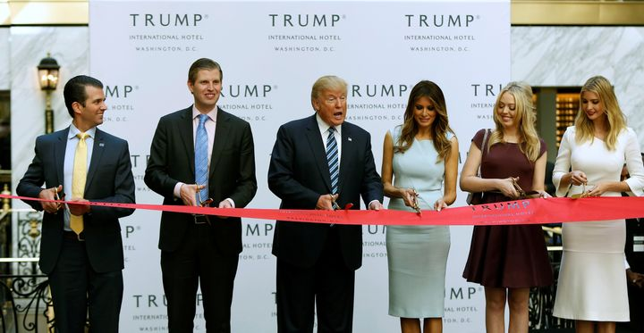 Donald Trump Jr., Eric Trump, Donald Trump, wife Melania, and daughters Tiffany and Ivanka Trump attend a ribbon-cutting at T