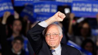 U.S. Democratic presidential candidate Bernie Sanders raises as fist as he speaks at his caucus night rally Des Moines, Iowa February 1, 2016, REUTERS/Rick Wilking