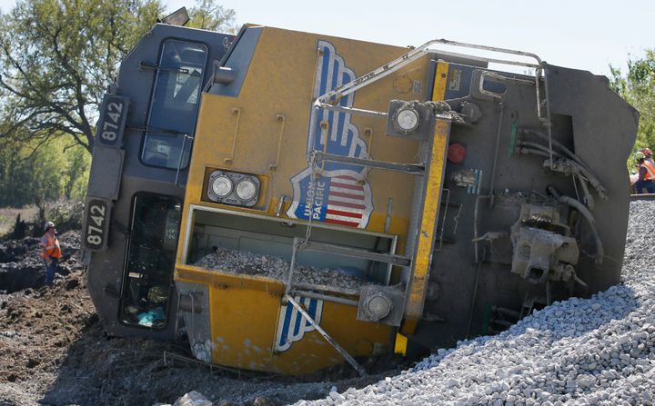 A Union Pacific train engine sits on its side waiting to be uprighted after the train was derailed by floodwaters near Corsic