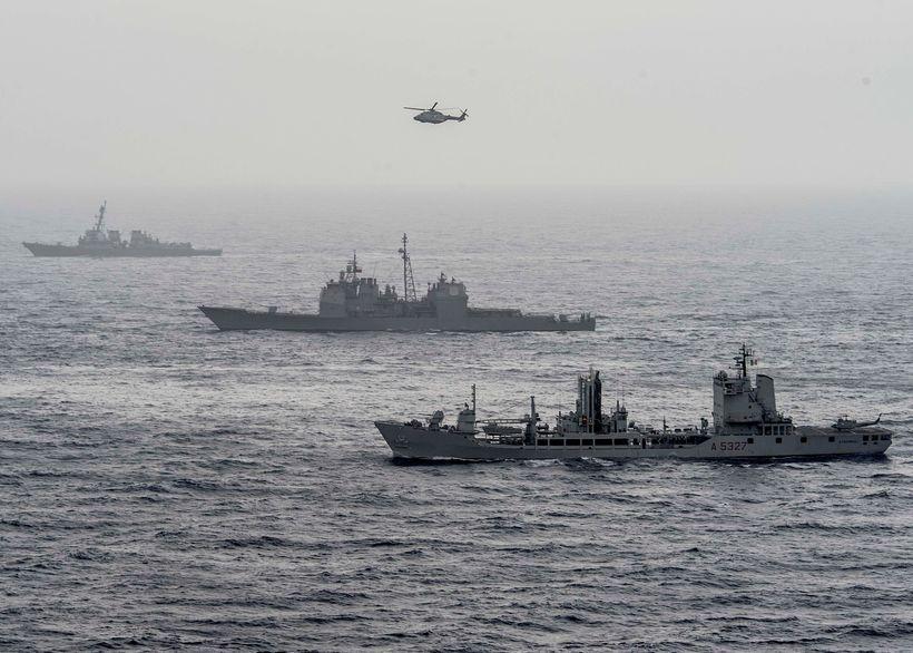 MEDITERRANEAN SEA (June 16, 2016) The guided-missile destroyer USS  Roosevelt (DDG 80), top, guided-missile cruiser USS San J
