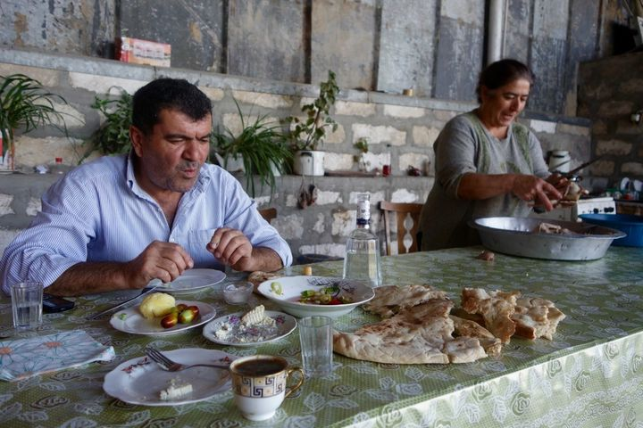 <p>Villagers invite me in for a meal in Nagorno-Karabakh. </p>