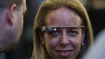 A woman wears a pair of Google glasses at the Zionist Union headquarters as they wait for the first official results of Israel's parliamentary elections on March 17, 2015 in the city of Tel Aviv. AFP PHOTO / THOMAS COEX        (Photo credit should read THOMAS COEX/AFP/Getty Images)