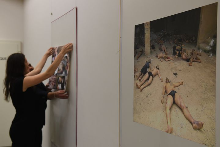 Photographs documenting Assad's torture of Syrians have been displayed across the world. They are seen here in Geneva, Switze