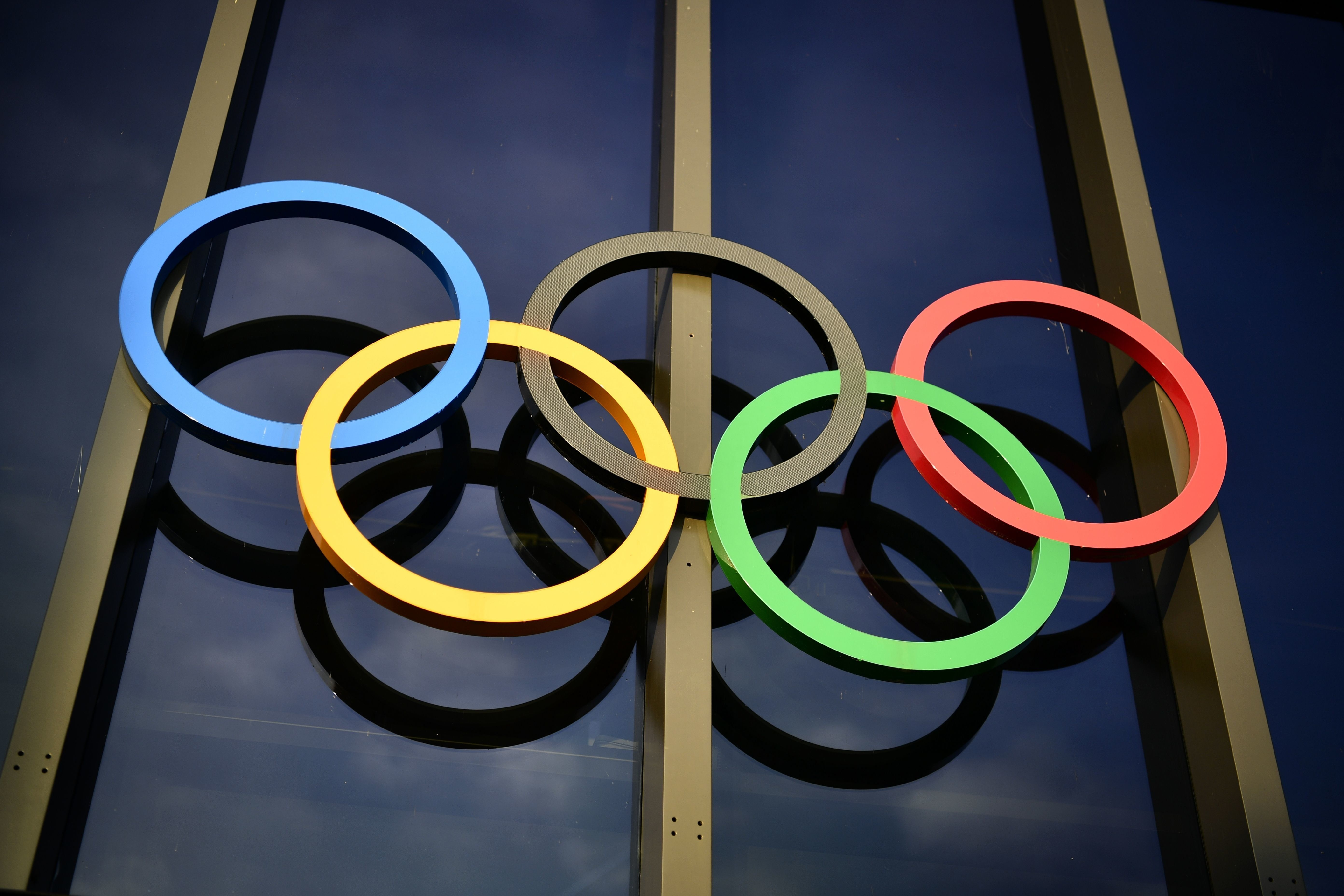The Olympic rings are seen above the entrance on the facade of the Olympic Museum in Lausanne, Switzerland, on December 7, 2016. / AFP / FABRICE COFFRINI        (Photo credit should read FABRICE COFFRINI/AFP/Getty Images)