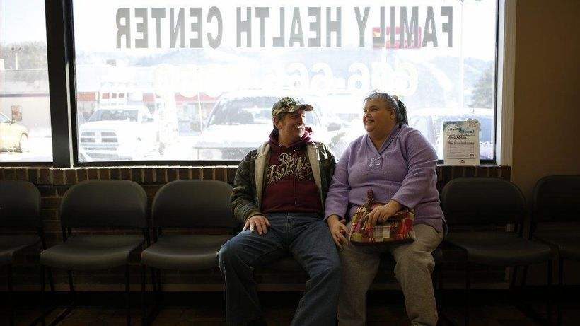 Mary Blair and her husband wait for a doctor's appointment at the Breathitt County Family Health Center in Kentucky, a state