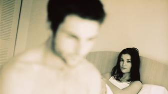 Disagreeable couple in bedroom