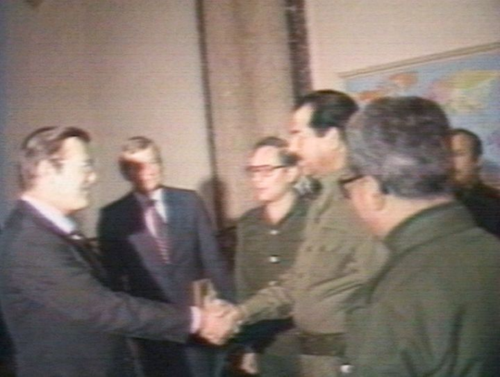 Donald Rumsfeld and Saddam Hussein shake hands in 1983 in Baghdad during the war between Iran and Iraq.
