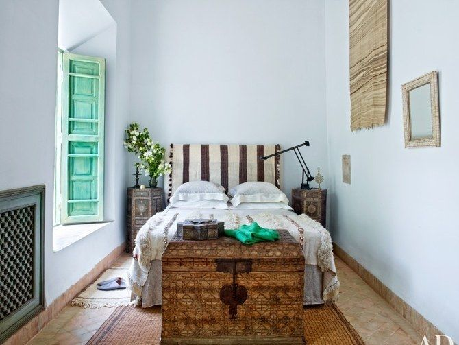 <p>An antique trunk, like this one in the bedroom of a home in Marrakech, makes for easy and pretty storage.</p>