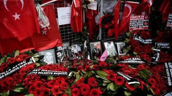 Flowers and pictures of victims have been laid in front in front of the Reina nightclub on January 4, 2017 in Istanbul, three days after a gunman killed 39 people on New Year's night.   The gunman had fought in Syria for Islamic State jihadists, a report said on January 3, as Turkish authorities intensified their hunt for the attacker. Of the 39 dead, 27 were foreigners, mainly from Arab countries, with coffins repatriated overnight to countries including Lebanon and Saudi Arabia. / AFP / OZAN KOSE        (Photo credit should read OZAN KOSE/AFP/Getty Images)