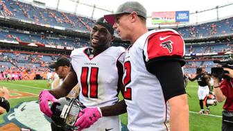 Oct 9, 2016; Denver, CO, USA; Atlanta Falcons wide receiver Julio Jones (11) and quarterback Matt Ryan (2) celebrate the win over the Denver Broncos in the second half at Sports Authority Field at Mile High. The Falcons defeated the Broncos 23-16. Mandatory Credit: Ron Chenoy-USA TODAY Sports