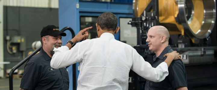 President Barack Obama talks with employees at the Linamar factory in Asheville, North Carolina, on Feb. 13, 2013.