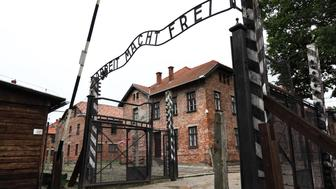 famous metal plate of auschwitz entrance gate