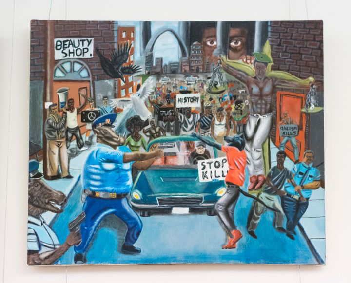 A controversial painting by Missouri student David Pulphus depicting police as animals hungin the tunnel connecting the