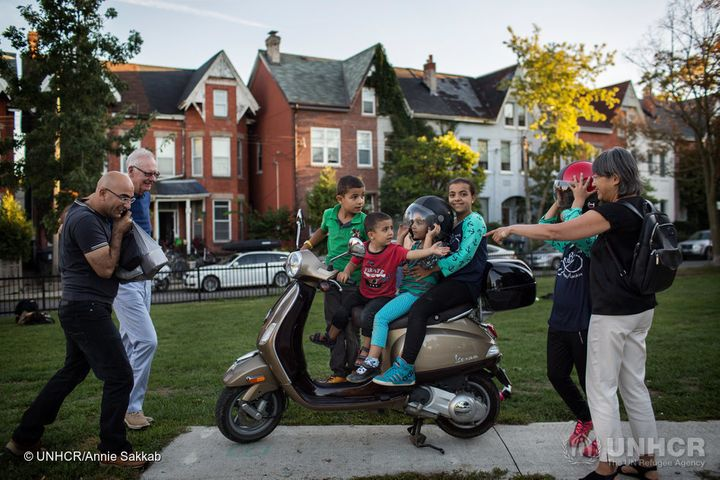 The Nouman children play on Michael Adam'€™s Vespa.