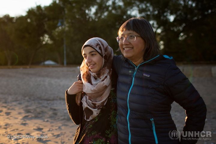 Thuy Nguyen and Narjes Nouman spend time at a beach in downtown Toronto.