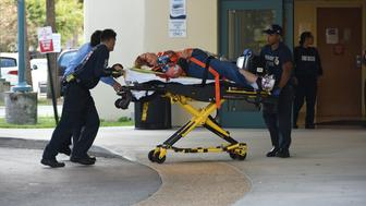 A shooting victim is unloaded from an emergency vehicle and taken into Broward Health Trauma Center Friday, Jan. 6, 2017 in Fort Lauderdale, Fla.  Authorities said multiple people have died after a lone suspect opened fire at the Ft. Lauderdale-Hollywood International Airport.  (Taimy Alvarez/South Florida Sun-Sentinel/TNS via Getty Images)