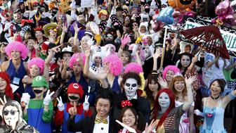 Participants in costume pose for a picture during a Halloween parade in Kawasaki, south of Tokyo, October 25, 2015. More than 100,000 spectators turned up to watch the parade, where 2,500 participants dressed up in costumes, according to the organiser. REUTERS/Yuya Shino