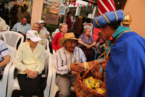Peruvian policemen dressed as the Three Kings greet spectators at the Canevaro old people's home during Epiphany celebrations