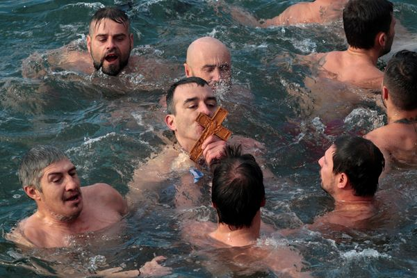 An Orthodox faithful kisses a wooden crucifix during Epiphany day celebrations in Thessaloniki, Greece January 6, 2017.