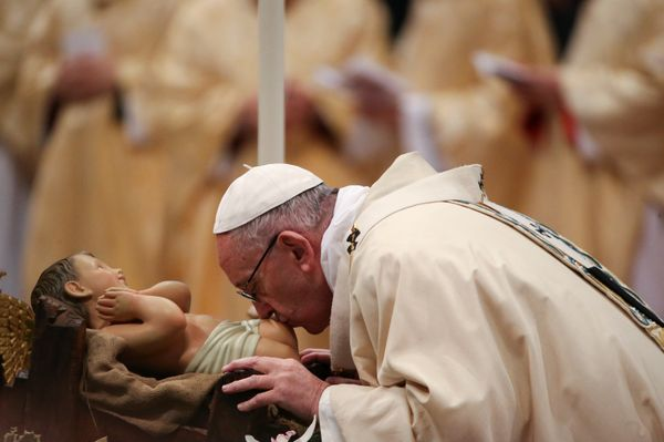 Pope Francis kisses the statue of baby Jesus during the Epiphany mass in Saint Peter's Basilica at the Vatican January 6, 201