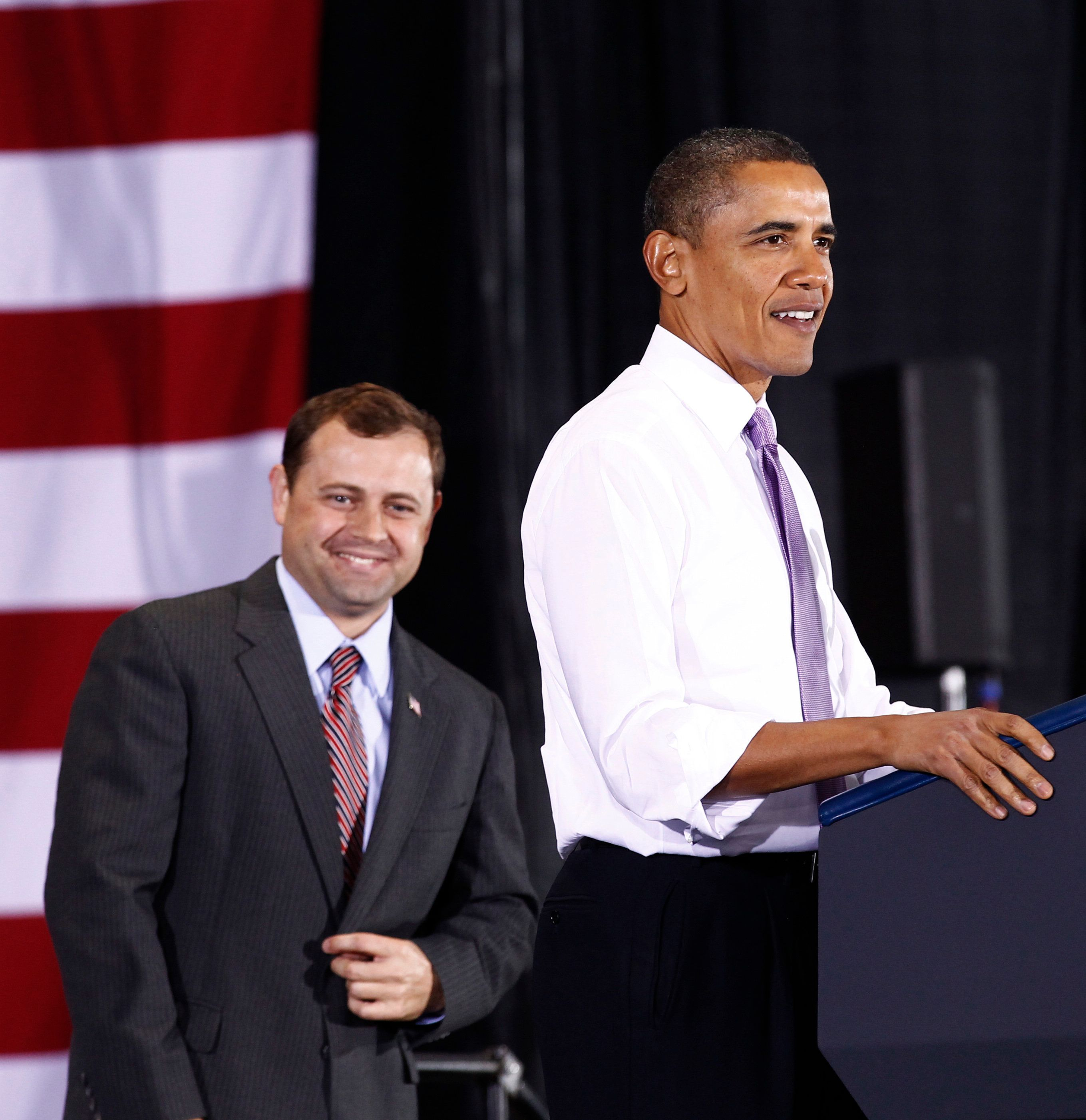 U.S. President Barack Obama speaks at a campaign rally for U.S. Representative Tom Perriello (L) in Charlottesville, Virginia October 29,  2010.   REUTERS/Kevin Lamarque (UNITED STATES - Tags: POLITICS ELECTIONS)