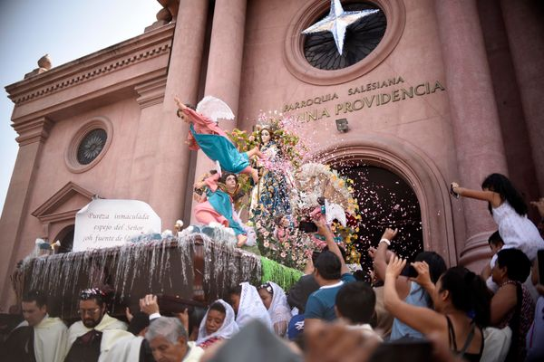 Catholic devotees carry a statue of the Virgin Mary during the Three Wise Men or Three Kings celebration on Epiphany at El Gu