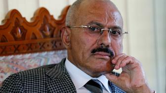 Yemen's former President Ali Abdullah Saleh pauses during an interview with Reuters in Sanaa May 21, 2014. Other Yemeni officials may have looted public funds, but Saleh says he was not one of them and he has challenged his authorities to find one dollar acquired inappropriately and hold him to account. His critics in Yemen, an impoverished country of 25 million where 40 percent of the population live on less than $2 per day, accuse him of embezzling billions of dollars during his 33 years in power. Picture taken May 21, 2014. To match Interview YEMEN-SALEH/              REUTERS/Khaled Abdullah (YEMEN - Tags: POLITICS HEADSHOT PROFILE)