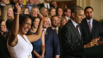 WASHINGTON, DC - MAY 03:  2016 National Teacher of the Year Jahana Hayes (L) of John F. Kennedy High School in Waterbury, CT, cheers as U.S. President Barack Obama delivers remarks during a ceremony to honor her and her fellow state teachers of the year in the East Room of the White House May 3, 2016 in Washington, DC. Obama talked about the influence and importance that each classroom instructor has on the lives of their students while honoring the teachers from all 50 states and U.S. territories.  (Photo by Chip Somodevilla/Getty Images)