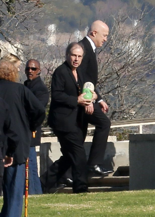 Carrie Fishers brother Todd carries her ashes at Forest Lawn Memorial Park