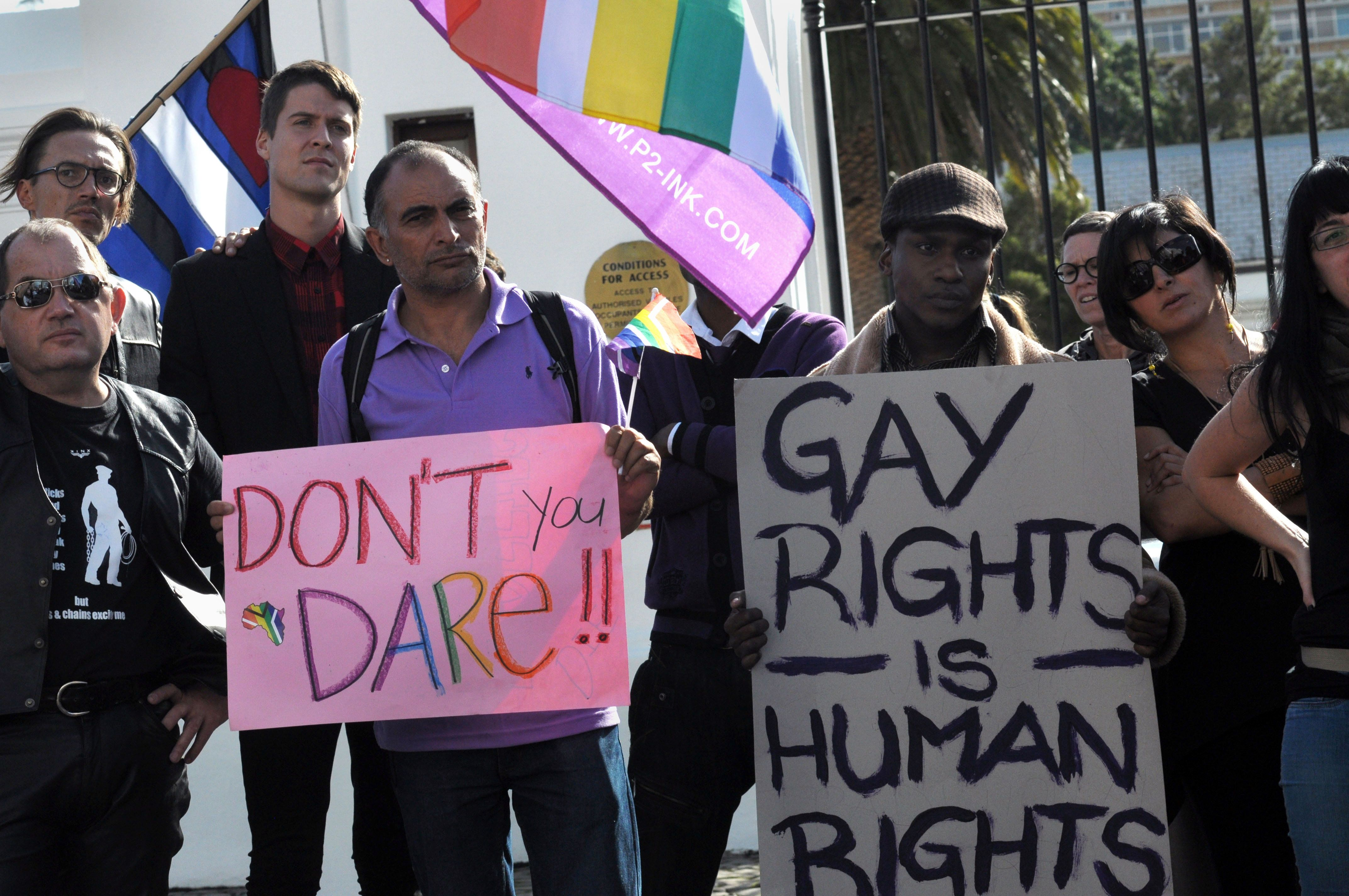 A group of people from the gay, lesbian and transgender community in South Africa demonstrate outside the Parliament in Cape Town, on May 19, 2012. The protesters gathered to oppose the proposal by the House of Traditional Leaders to remove the term 'sexual orientation' from section 9 (3) of the South African Constitution, which prohibits unfair discrimination.  AFP PHOTO / RODGER BOSCH        (Photo credit should read RODGER BOSCH/AFP/GettyImages)