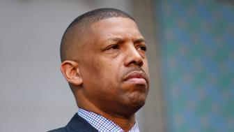 Sacramento Mayor Kevin Johnson, working on behalf of the National Basketball Players Association, attends at a news conference outside City Hall in Los Angeles, California, April 29, 2014. he National Basketball Association on Tuesday banned Los Angeles Clippers owner Donald Sterling from the game for life and fined him $2.5 million (1.4 million pounds) for racist comments that outraged everyone from players, to fans, coaches and the U.S. president.   REUTERS/David McNew (UNITED STATES - Tags: SPORT POLITICS)