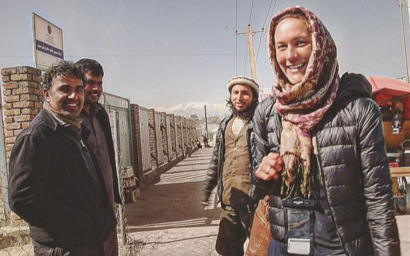 Cassie with locals in Afghanistan.