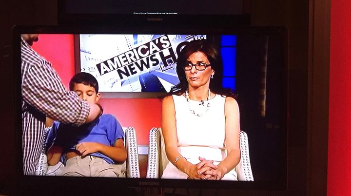 <p>My son and I waiting to be interviewed.</p>