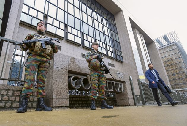 Armed soldiers stand guard outside the European Council headquarters, on Nov. 17, 2015. Salah Abdeslam,...