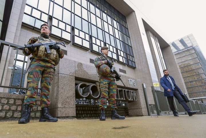 Armed soldiers stand guard outside the European Council headquarters, on Nov. 17, 2015. Salah Abdeslam, a French national who