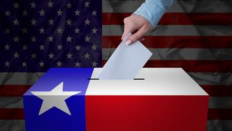 A hand casting a vote in a ballot box for an election in the Texas, USA