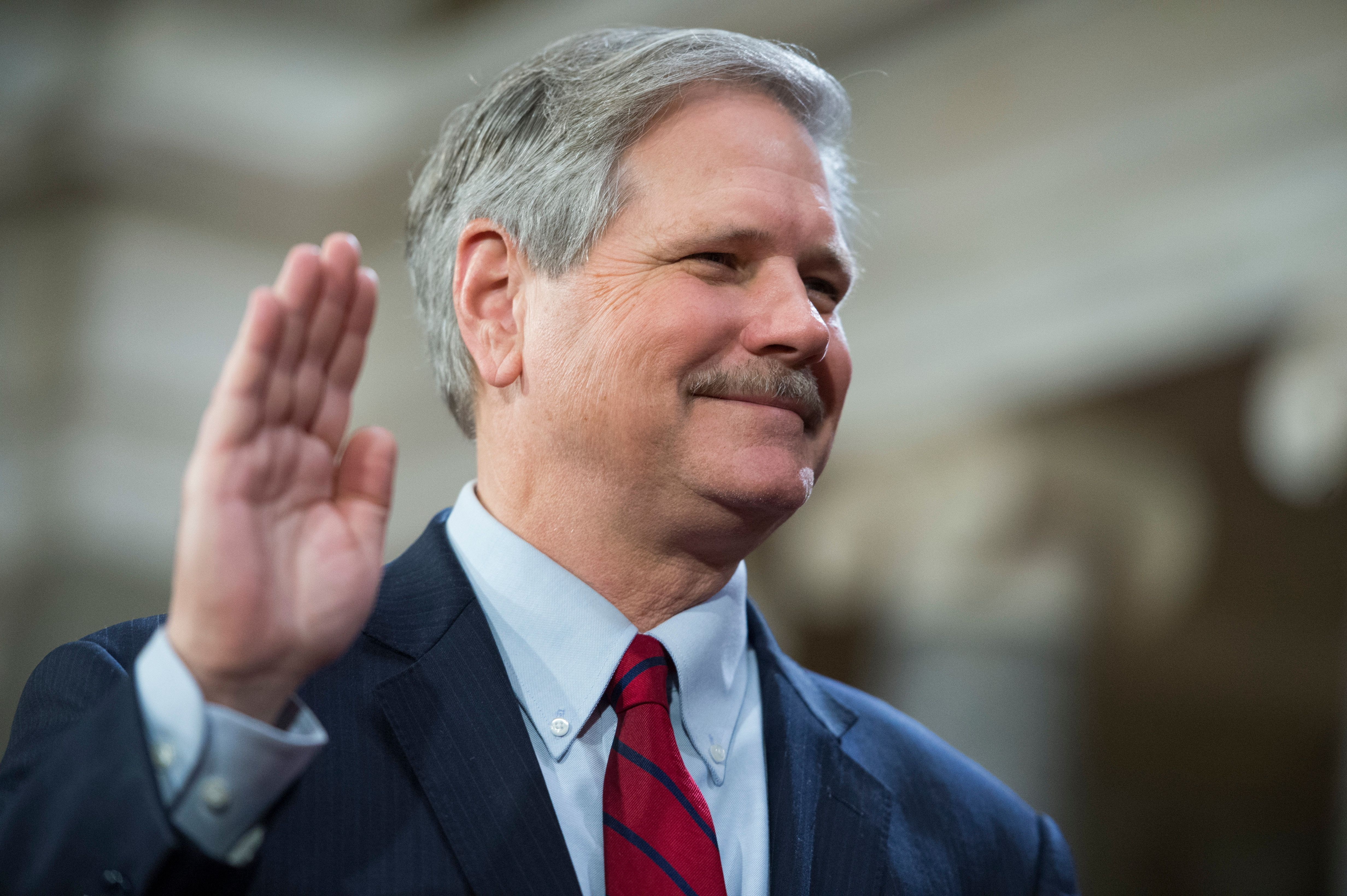UNITED STATES - JANUARY 03: Sen. John Hoeven, R-N.D., is administered an oath by Vice President Joe Biden during a swearing-in ceremony in the Capitol's Old Senate Chamber, January 03, 2016. (Photo By Tom Williams/CQ Roll Call)