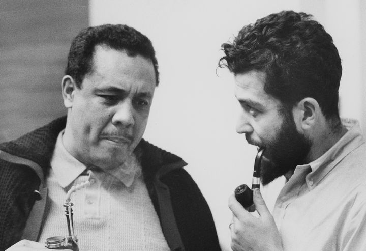 Jazz great Charles Mingus, left, smokes a pipe with a young Nat Hentoff sometime in the late 1950s or early '60s.