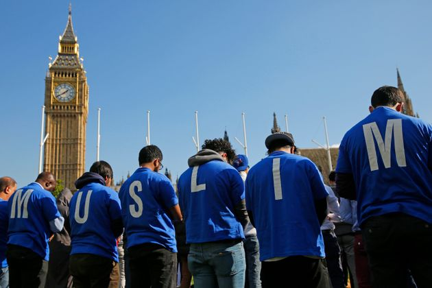 Muslims take part in Friday prayers during a Muslim Climate Action (MCA) event at Parliament Square in...