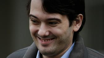 Martin Shkreli, former chief executive officer of Turing Pharmaceuticals LLC, smiles while exiting federal court in the Brooklyn borough of New York, U.S., on Wednesday, Feb. 3, 2016. Shkreli, charged with securities fraud and called before a congressional panel, has replaced his legal team with Benjamin Brafman, the lawyer who helped get Sean 'Diddy' Combs acquitted of gun and bribery charges in 2001. Photographer: Peter Foley/Bloomberg via Getty Images
