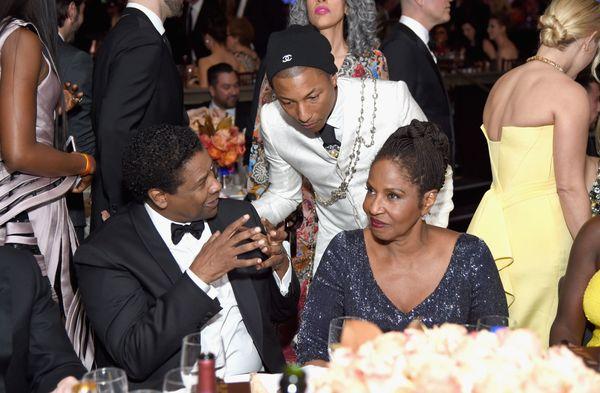 Denzel Washington and Pharrell Williams sharing a moment.